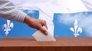 Hand putting a ballot into a ballot box. Quebec flag in the background.
